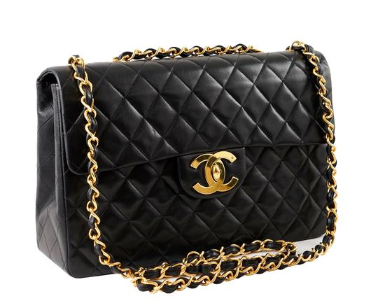 Preload https://item1.tradesy.com/images/chanel-255-reissue-classic-flap-classic-maxi-quilted-maxi-black-lambskin-leather-shoulder-bag-21370895-0-3.jpg?width=440&height=440