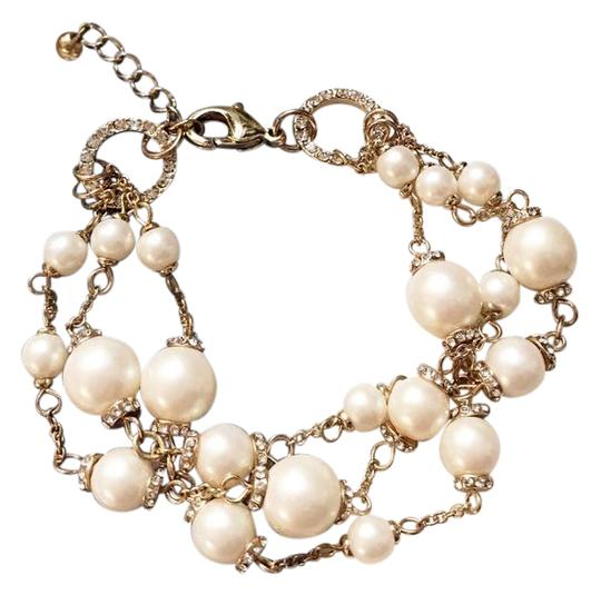 Preload https://img-static.tradesy.com/item/21372270/topshop-gold-elegant-multi-layer-pearl-bracelet-0-1-540-540.jpg