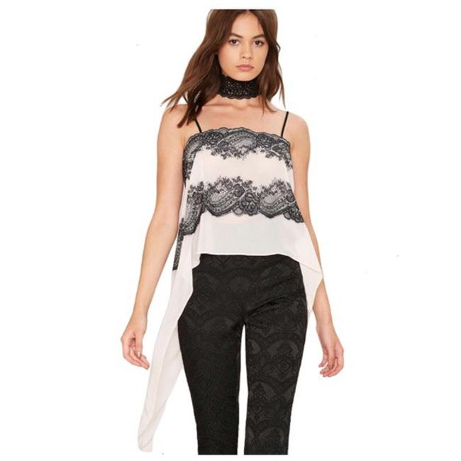 Preload https://img-static.tradesy.com/item/21372478/off-white-eyelash-lace-tuxedo-tail-blouse-size-12-l-0-0-650-650.jpg