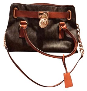 Michael Kors Satchel in brown with gold tone hardware accent