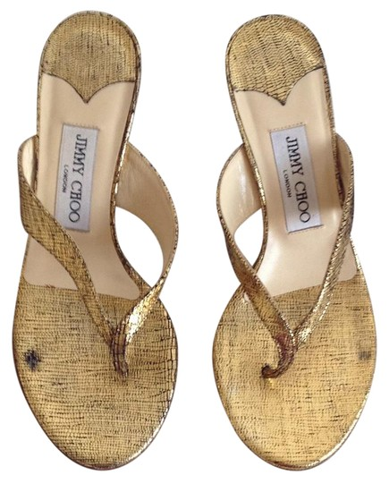 Preload https://img-static.tradesy.com/item/21379769/jimmy-choo-gold-black-sandals-size-us-55-0-1-540-540.jpg