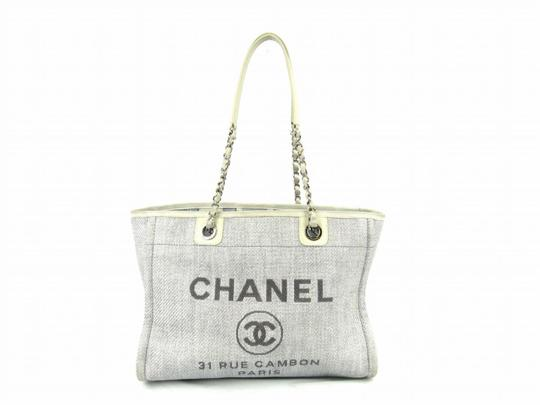 Preload https://img-static.tradesy.com/item/21383328/chanel-shopping-deauville-tote-light-blue-gray-canvas-shoulder-bag-0-0-540-540.jpg