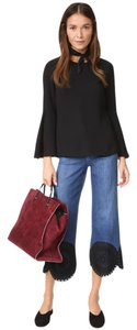 Elizabeth and James Iro Tory Burch The Row Helmut Lang Tibi Top Black