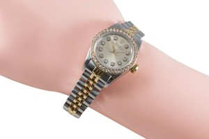 Rolex Ladies Rolex Oyster 67193 18K Gold Diamond Dial Bezel Watch