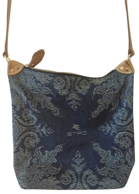 Item - Blue Denim with Withe Stitched Paisley Print. Interior Is Purple Striped. and Leather Cross Body Bag