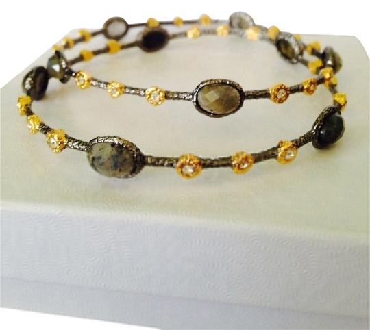 Preload https://item3.tradesy.com/images/alexis-bittar-goldblack-each-separately-faceted-blue-and-green-labradorite-and-white-topaz-bangle-2138862-0-0.jpg?width=440&height=440