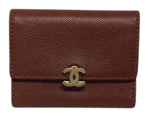 Chanel Brown leather bi fold credit card wallet with bronze CC clasp