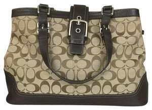 Coach Satchel in Dark brown with beige.