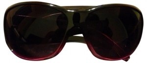 New York & Company Purple sunglasses with silver lion crest