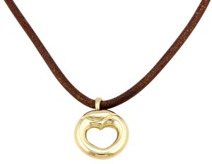 Movado 13913 - 18k Yellow Gold Heart Pendant Brown Leather Cord Necklace