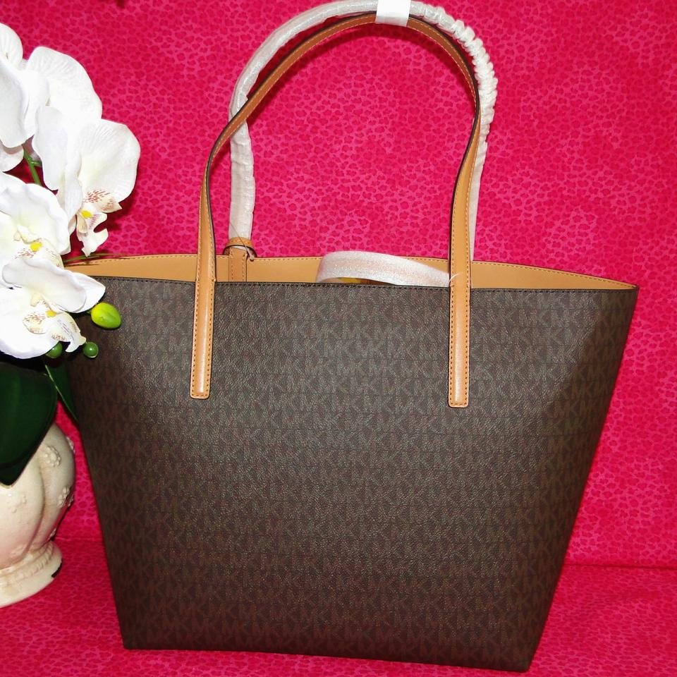 47e6a8b3250d Michael Kors Hayley and Pouch Brown Coated Cotton Tote - Tradesy