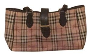 Burberry Tote in Brown and tan. Brown leather straps with gold hardware. Brown changing pad.