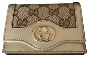 Gucci Gucci cardholder/wallet, golden color. Used only twice. Like new!