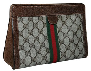Gucci Accessory Collection Made In Italy Canves Monogram Vintage Brown Clutch