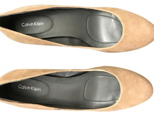 Calvin Klein beige with animal print on the heel Pumps