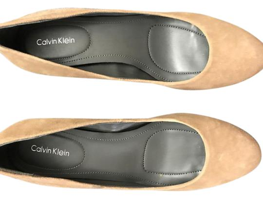 Preload https://item1.tradesy.com/images/calvin-klein-beige-with-animal-print-on-the-heel-unknown-pumps-size-us-95-regular-m-b-21451760-0-1.jpg?width=440&height=440