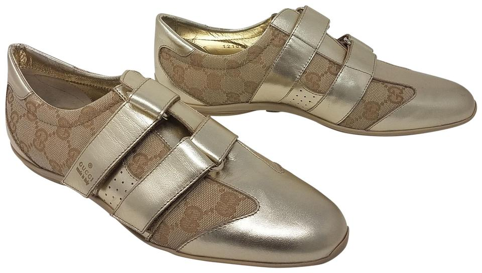 5bc250ffbec Gucci Beige Gold Gold-tone Metallic Leather Print Sneakers Sneakers. Size  EU  37 (Approx. US 7) ...