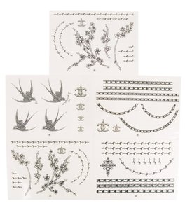 Chanel Set of 55 black, ivory Chanel temporary tattoos