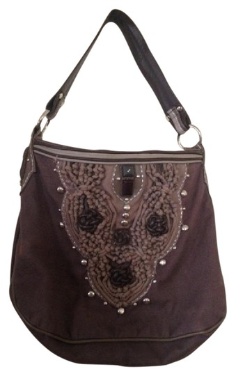 Preload https://img-static.tradesy.com/item/21464051/studded-knot-slim-brown-canvas-and-leather-hobo-bag-0-1-540-540.jpg