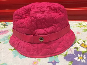 f09abc270ad Coach Coach Shocking Pink Quilted Monogramed Bucket Hat (size small petite)
