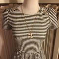 Juicy Couture Black/White/Gold Nwot-sz & Striped /Gold Logo Shoulder Button Sleeved Mid-length Short Casual Dress Size 4 (S) Juicy Couture Black/White/Gold Nwot-sz & Striped /Gold Logo Shoulder Button Sleeved Mid-length Short Casual Dress Size 4 (S) Image 8