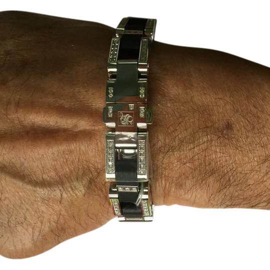 Preload https://img-static.tradesy.com/item/21466771/stainless-steel-and-black-ny-collection-bracelet-0-1-540-540.jpg