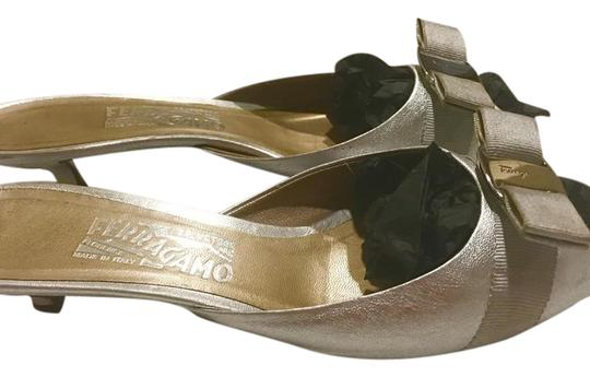 Preload https://img-static.tradesy.com/item/21467362/salvatore-ferragamo-silver-c-sandals-size-us-85-regular-m-b-0-1-540-540.jpg