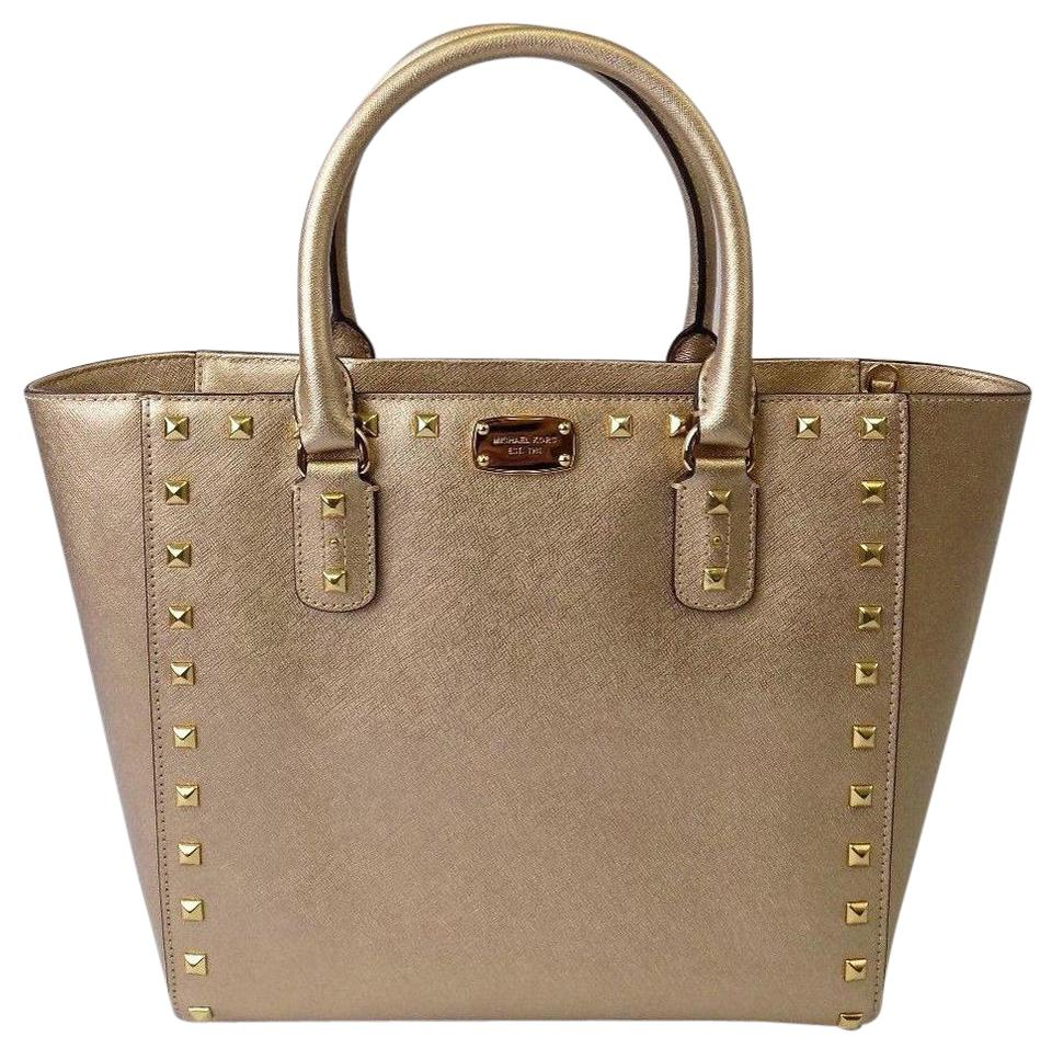 9b38fd962a43 Michael Kors Mk Saffiano Leather Mk Crossbody Bags Studded Tote in Gold  Image 0 ...