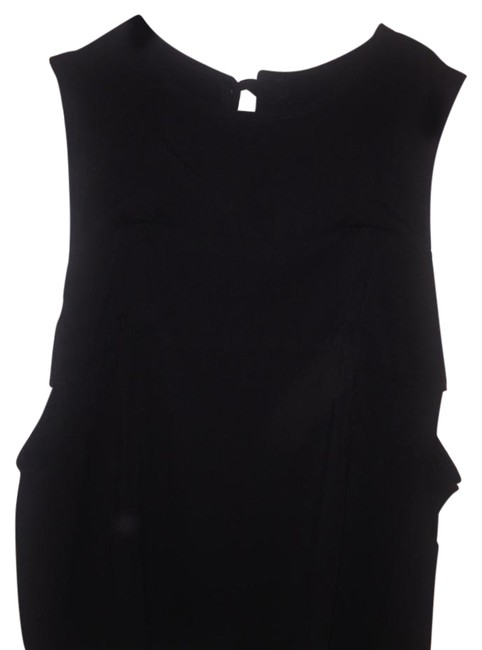 Preload https://item3.tradesy.com/images/forever-21-black-sleeveless-tank-night-out-top-size-8-m-21484737-0-1.jpg?width=400&height=650