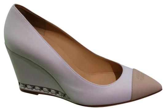 Preload https://item2.tradesy.com/images/chanel-white-nude-two-tone-cap-toe-goatskin-leather-wedges-with-chain-pumps-size-us-75-regular-m-b-21490466-0-1.jpg?width=440&height=440