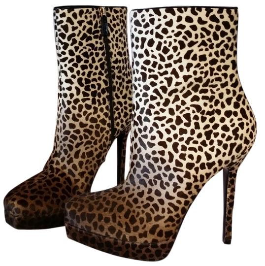 Preload https://item2.tradesy.com/images/gucci-pony-hair-animal-print-boots-2149451-0-0.jpg?width=440&height=440