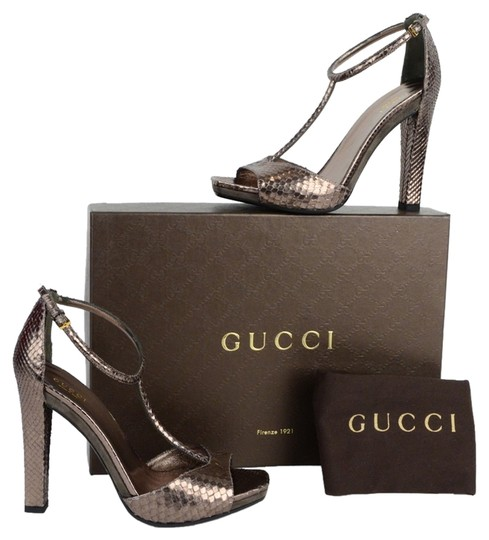 Preload https://item3.tradesy.com/images/gucci-metallics-daisy-python-leather-high-heel-t-strap-ankle-strap-sandals-size-us-9-2149887-0-0.jpg?width=440&height=440