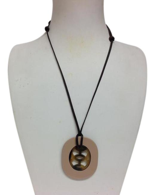 Item - Nude Buffalo Horn Lift Pendant On Adjustable Cord Necklace