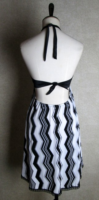 Lisa Nieves short dress black.white Halter Short Stretchy Print on Tradesy