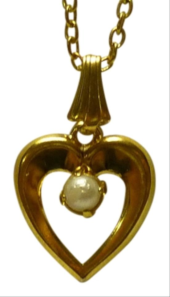 Gold pearl golden heart shaped pendant with a bead in the center other golden heart shaped pendant with a pearl bead in the center aloadofball Images