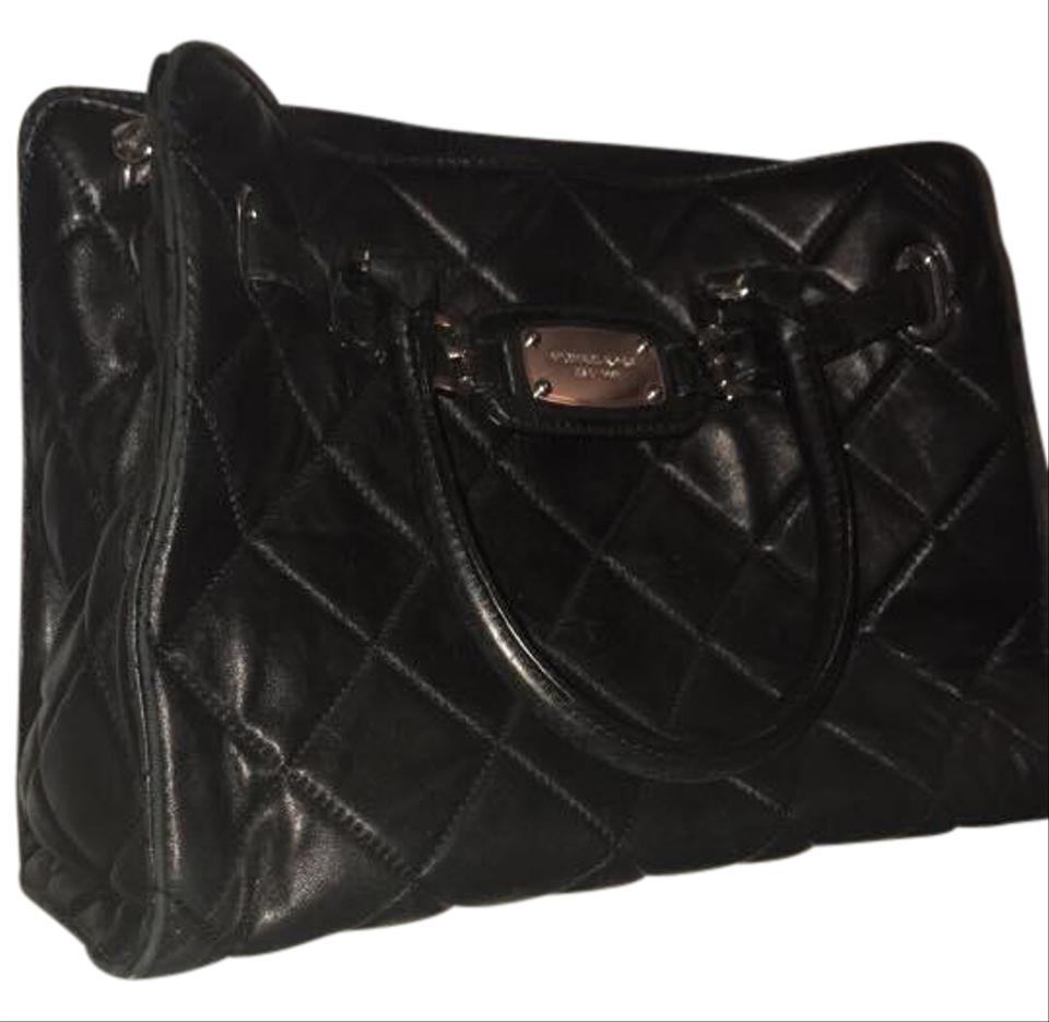 0aa79f70b66333 Michael Kors Lambskin Quilted Silver Hardware Pockets Tote in black Image 0  ...
