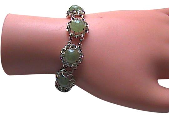 Preload https://img-static.tradesy.com/item/21532540/sterling-silver-light-spinach-color-jade-cabochon-bracelet-0-1-540-540.jpg