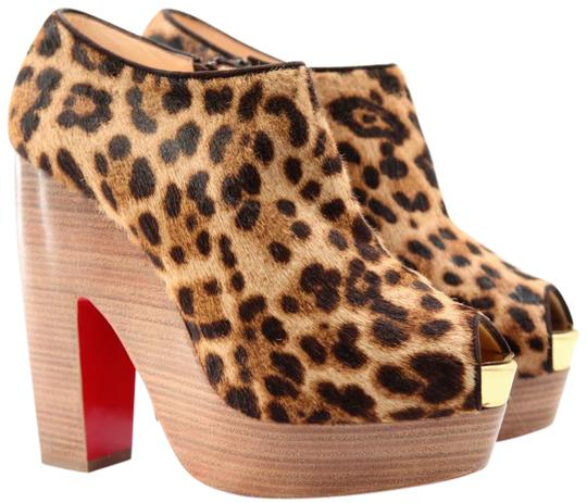 Preload https://img-static.tradesy.com/item/21540944/christian-louboutin-leopard-print-38-pony-hair-platform-140-wedge-high-heel-lady-red-sandal-pump-ank-0-1-540-540.jpg