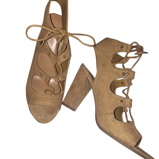 Preload https://item5.tradesy.com/images/irabel-brown-tan-suede-lace-up-sandals-size-us-85-regular-m-b-21542204-0-1.jpg?width=440&height=440