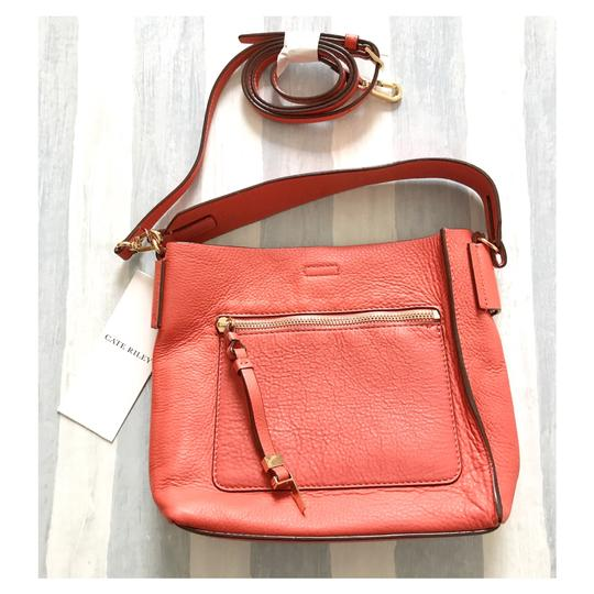 Preload https://img-static.tradesy.com/item/21542209/tia-small-bucket-coral-red-leather-cross-body-bag-0-0-540-540.jpg
