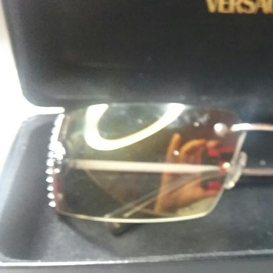 Versace COLORSKUSIZEUNIT PRICE  Versace Embellished Rimless Sunglasses Silver Metal Versace Rimless Sunglasses With Tinted Brown Lenses And Silver-Tone Embellished Logo...SilverVES27325
