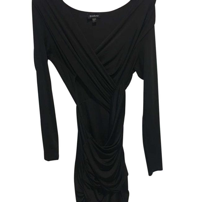 Preload https://img-static.tradesy.com/item/21543783/bebe-black-cut-mid-length-night-out-dress-size-12-l-0-1-650-650.jpg