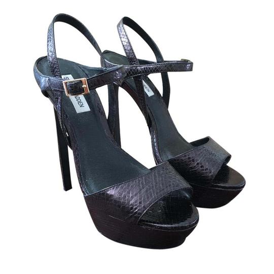 Preload https://img-static.tradesy.com/item/21543873/steve-madden-black-snakeskin-stiletto-platforms-size-us-9-regular-m-b-0-1-540-540.jpg