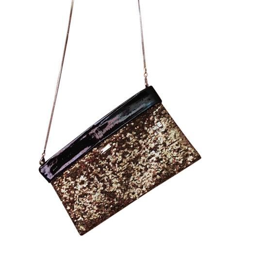 Preload https://item5.tradesy.com/images/kate-spade-black-and-gold-patent-leather-cross-body-bag-21544794-0-1.jpg?width=440&height=440