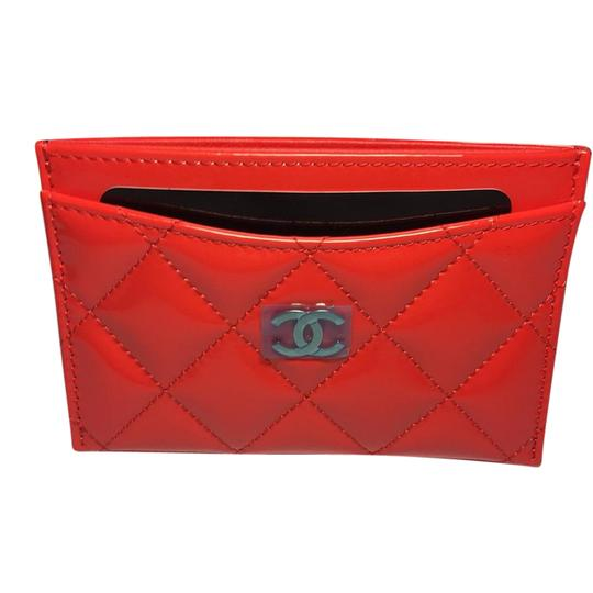 Preload https://item2.tradesy.com/images/chanel-tomato-red-bn-17c-classic-patent-card-holder-shw-wallet-21545171-0-3.jpg?width=440&height=440