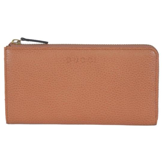 Preload https://item3.tradesy.com/images/gucci-saffron-brown-leather-women-s-leather-zip-332747-cao0o-wallet-21546617-0-0.jpg?width=440&height=440