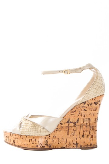 Preload https://item4.tradesy.com/images/dior-ivory-python-trim-leather-wedge-sandals-size-us-8-regular-m-b-21546683-0-0.jpg?width=440&height=440