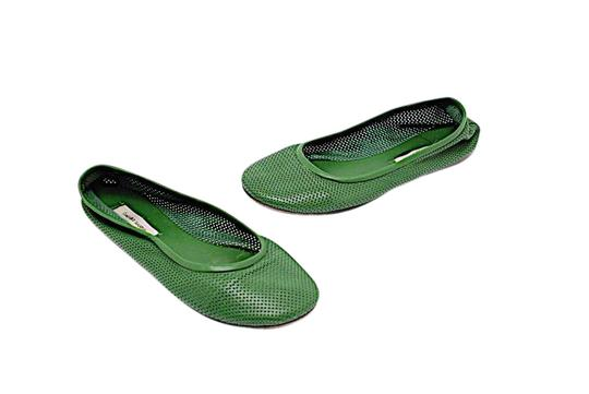 Preload https://img-static.tradesy.com/item/21548274/forest-green-perforated-leather-flats-size-us-7-regular-m-b-0-1-540-540.jpg