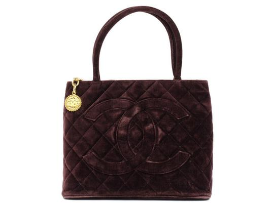 Preload https://item3.tradesy.com/images/chanel-medallion-quilted-cc-219438-brown-velour-tote-21548462-0-0.jpg?width=440&height=440