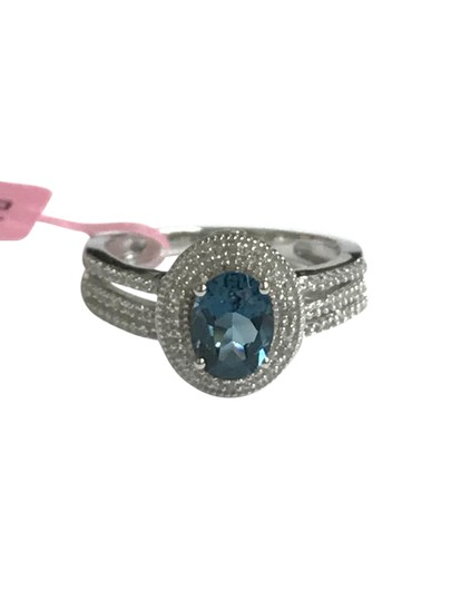 Preload https://img-static.tradesy.com/item/21548698/blue-sterling-triple-band-halo-london-topaz-and-cz-cocktail-ring-0-1-540-540.jpg